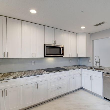 Rent this 2 bed condo on Lakes of Delray Blvd in Delray Beach, FL