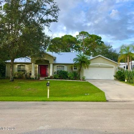 Rent this 3 bed house on Espejo St SE in Palm Bay, FL