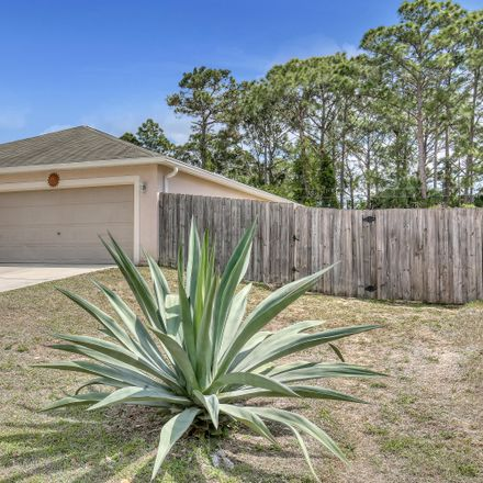 Rent this 4 bed house on Trinidad Ave SE in Palm Bay, FL