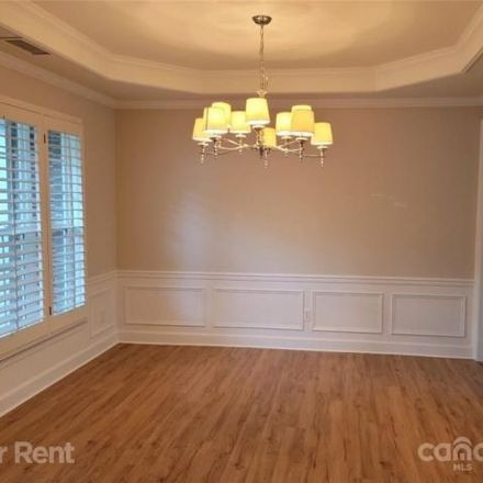 Rent this 4 bed house on 10797 Knight Castle Drive in Piper Glen, NC 28277