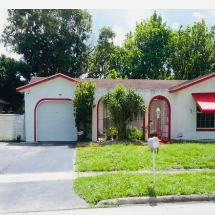 Rent this 3 bed house on SW 62nd Ave in Pompano Beach, FL