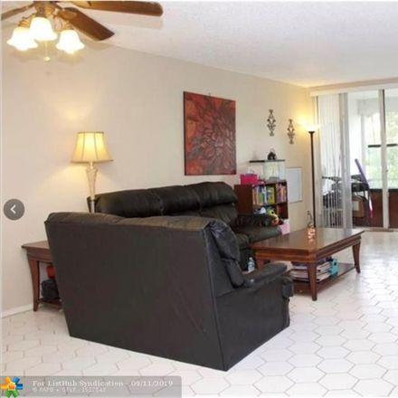Rent this 2 bed condo on 605 Oaks Drive in Pompano Beach, FL 33069