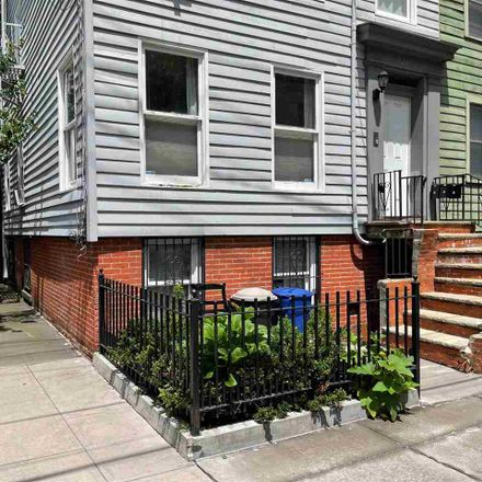 Rent this 2 bed townhouse on 3rd St in Jersey City, NJ