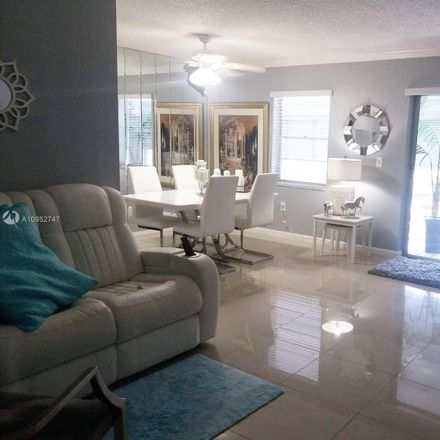 Rent this 2 bed condo on 4980 East Sabal Palm Boulevard in Tamarac, FL 33319