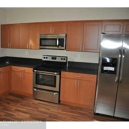 Rent this 2 bed townhouse on SW 14th Ave in Fort Lauderdale, FL