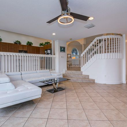 Rent this 4 bed house on 9851 Woolworth Court in Wellington, FL 33414