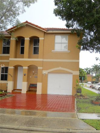 Rent this 3 bed townhouse on 13596 Northwest 9th Court in Pembroke Pines, FL 33028
