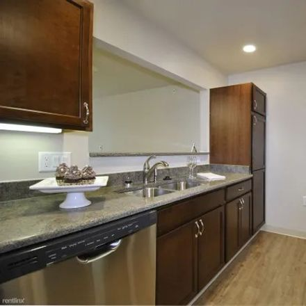 Rent this 2 bed apartment on 5525 Manor Drive in Lansing, MI 48911