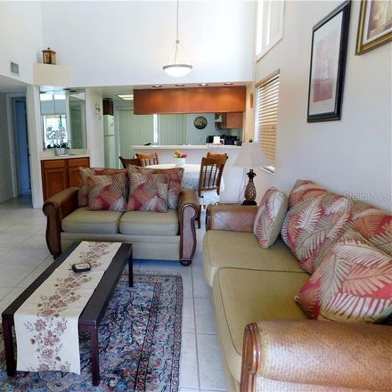 Rent this 2 bed condo on 338 Woodlake Wynde in Harbor Palms, FL 34677