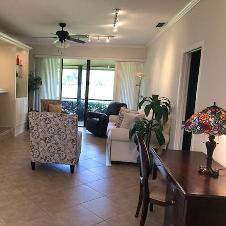 Rent this 2 bed townhouse on Old Meadow Way in West Palm Beach, FL