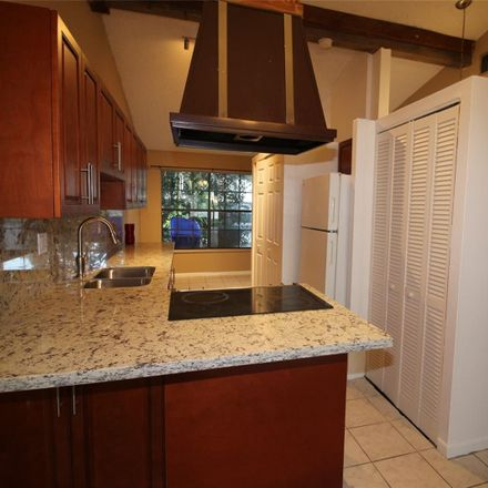 Rent this 2 bed townhouse on Buttonwood Avenue in Pembroke Pines, FL 33026