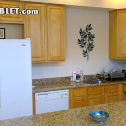 Rent this 3 bed townhouse on Lake Bellevue in Pomelo Avenue, Clearwater