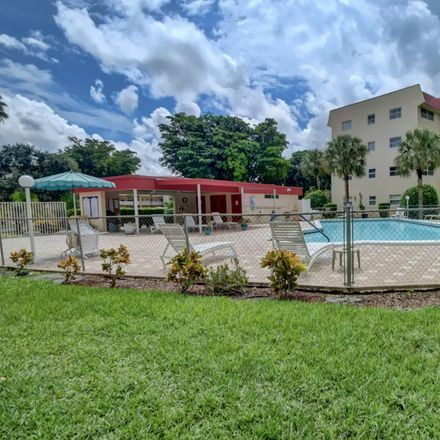 Rent this 2 bed apartment on 1045 Country Club Drive in Margate, FL 33063