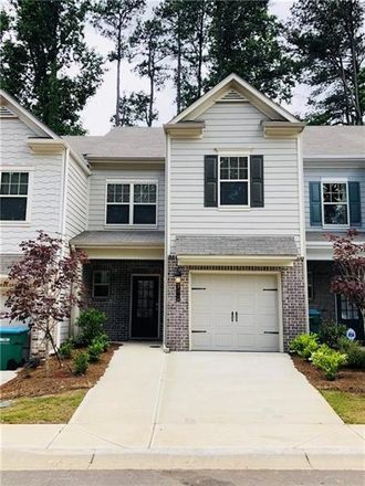 Rent this 2 bed townhouse on Park Ave in Atlanta, GA
