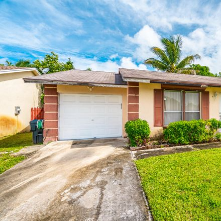 Rent this 4 bed house on 6055 Blue Stone Ln in Lake Worth, FL