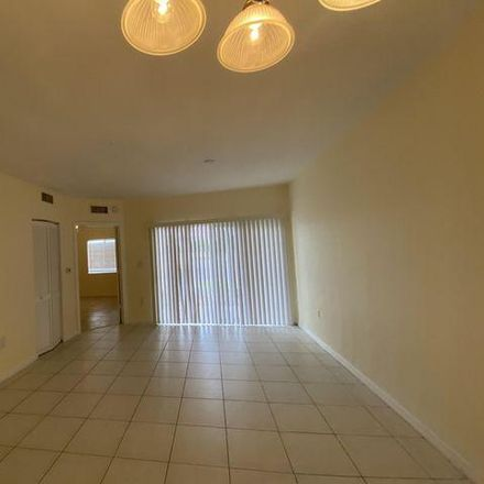 Rent this 3 bed condo on Golden Lakes Boulevard in West Palm Beach, FL 33411