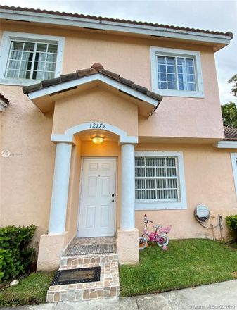 Rent this 3 bed townhouse on 12174 Southwest 143rd Lane in Three Lakes, FL 33186