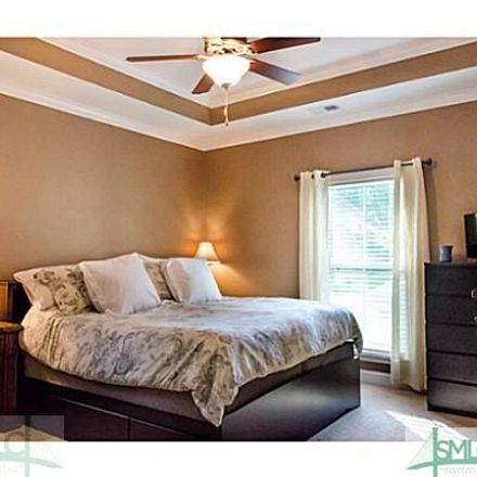 Rent this 4 bed house on Golden Way in Richmond Hill, GA