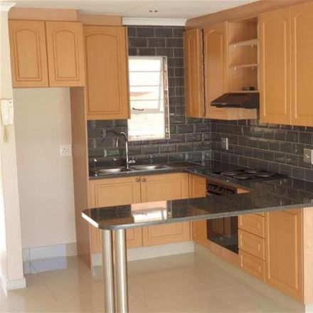 Rent this 2 bed townhouse on Oxford Road in Johannesburg Ward 118, Gauteng