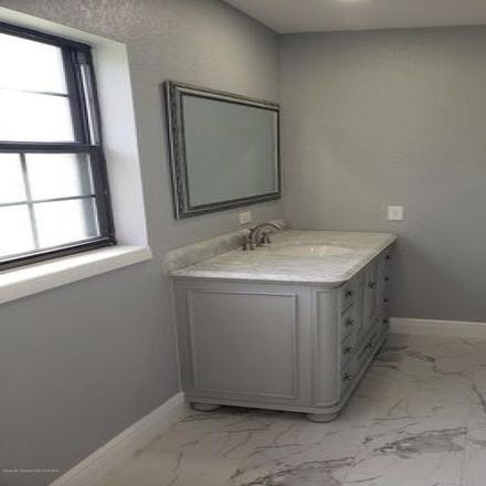 Rent this 3 bed house on 914 Poinsettia Avenue in Titusville, FL 32796