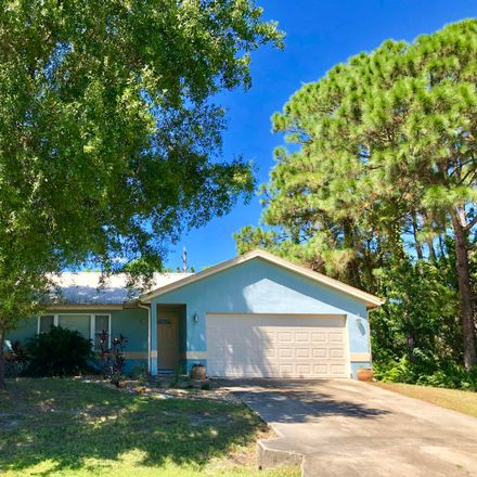 Rent this 3 bed apartment on Queens St SE in Palm Bay, FL