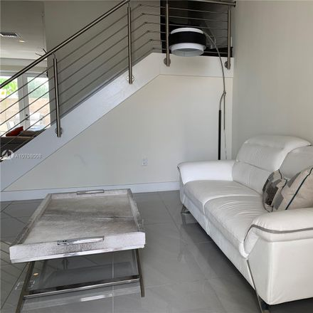 Rent this 4 bed townhouse on 6326 Northwest 104th Court in Doral, FL 33178