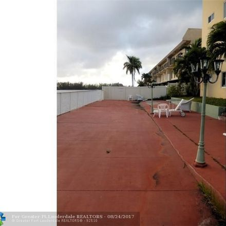 Rent this 3 bed condo on Crystal Lake Drive in Deerfield Beach, FL 33064