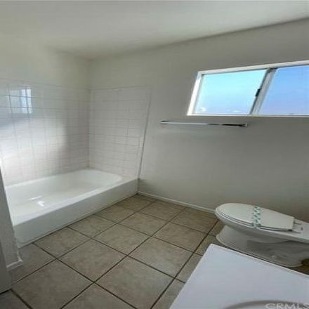 Rent this 3 bed house on 2096 East 111th Street in Los Angeles, CA 90059
