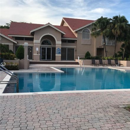 Rent this 2 bed condo on 10520 Southwest 158th Court in The Hammocks, FL 33196