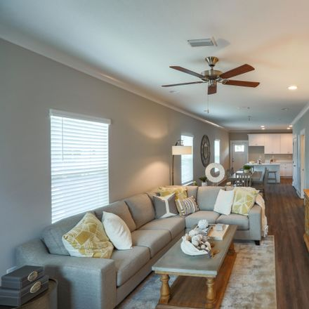 Rent this 3 bed townhouse on N Sand Palm Dr in Freeport, FL