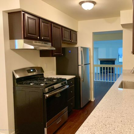 Rent this 2 bed condo on 13 Chestnut Way in Manalapan Township, NJ 07726