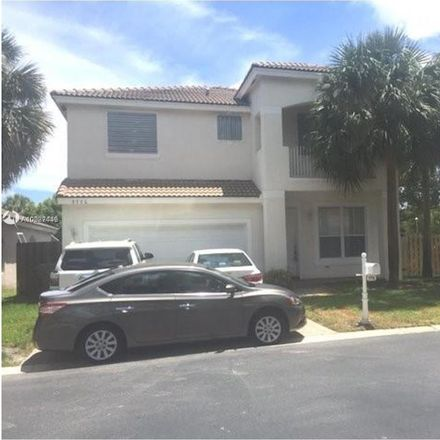 Rent this 4 bed loft on 7776 Northwest 19th Court in Pembroke Pines, FL 33024