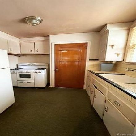 Rent this 3 bed house on 869 Riverbank Street in Lincoln Park, MI 48146
