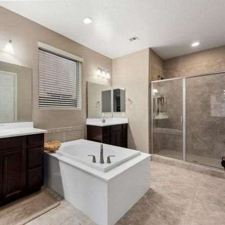 Rent this 4 bed house on West Quail Track Drive in Peoria, AZ 85383-3223
