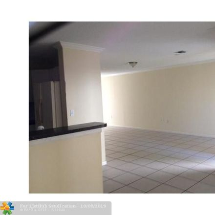 Rent this 4 bed house on 4141 Eastridge Circle in Deerfield Beach, FL 33064