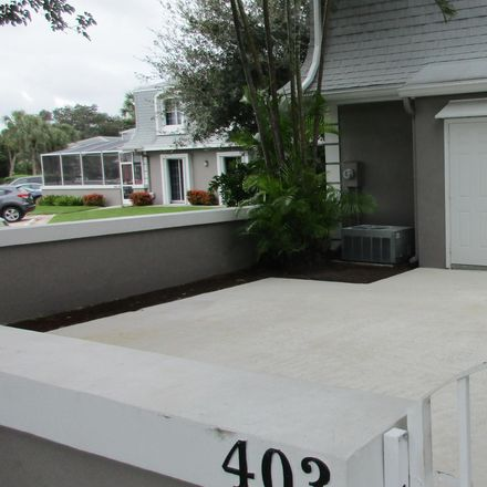 Rent this 3 bed townhouse on Vision Court in Palm Beach Gardens, FL 33410