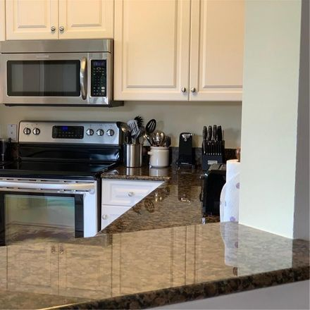 Rent this 2 bed condo on 10540 Amiata Way in Fort Myers, FL 33913