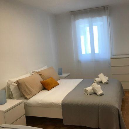 Rent this 8 bed room on Rua Ferreira de Castro 333 in 1950-136 Lisbon, Portugal
